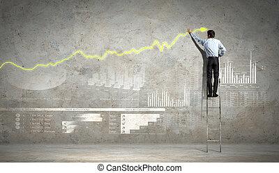 businessman drawing diagram - businessman standing on ladder...