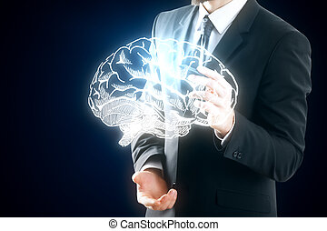 Businessman drawing digital brain