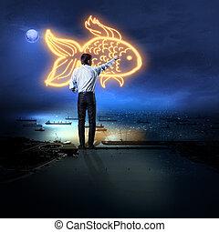 Businessman drawing gold fish