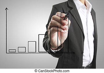 Businessman drawing growing graph - Businessman drawing...