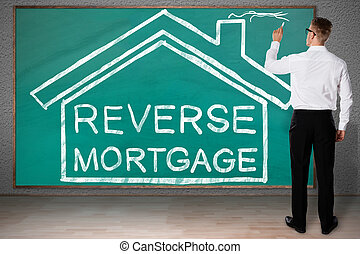 Businessman Drawing House With Reverse Mortgage Text - Full ...