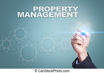Businessman drawing on virtual screen. property management...