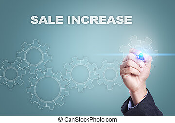 Businessman drawing on virtual screen. sale increase concept