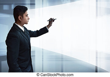 Businessman drawing on virtual screen