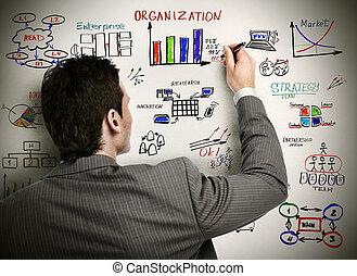Businessman drawing organisation scheme. - Businessman and ...