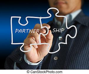 partnership written puzzle pieces - businessman drawing...