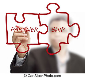 "businessman drawing ""partnership"" written puzzle pieces"