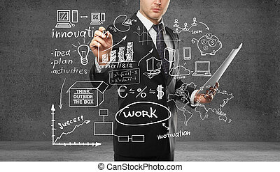 businessman drawing plan