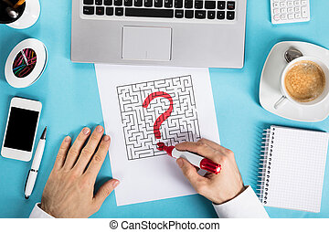 Businessman Drawing Question Mark Icon On Labyrinth Maze