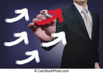 Businessman drawing rising arrows