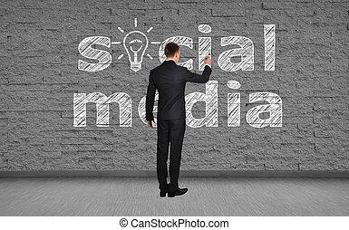 man drawing social media
