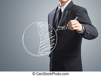 Businessman drawing target chart