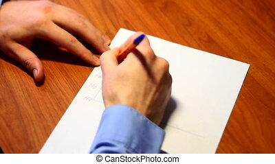 statistics - businessman draws a graph of statistics