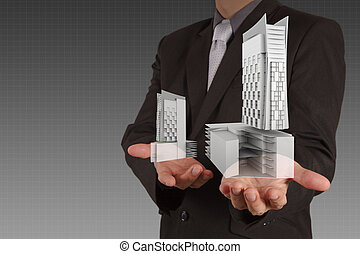 businessman draws building development
