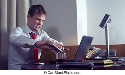 businessman drinking alcohol while working with his laptop at night, 4k