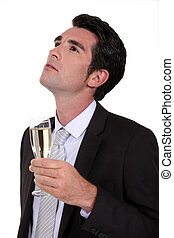 Businessman drinking champagne alone