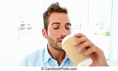 Businessman drinking coffee and giv