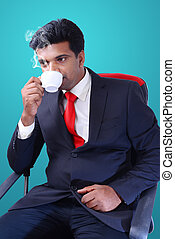 businessman drinking coffee in the