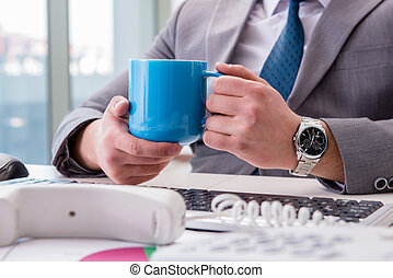 Businessman drinking coffee in the office