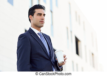 Young Attractive Businessman With Take Away Coffee Running