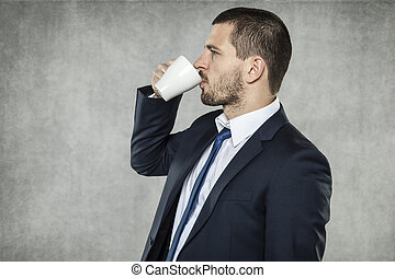 businessman drinking coffee to the bottom