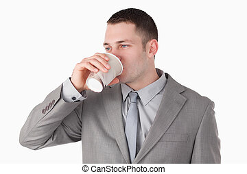 Businessman drinking tea