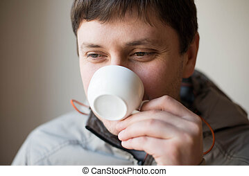 Businessman drinking tea, coffee
