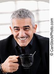 Businessman drinking tea - Happy mature businessman drinking...