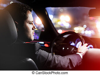 man driving a car at night - businessman driving a car at...