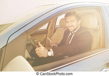 Businessman driving car