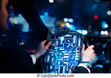 Businessman driving car with taxi interface