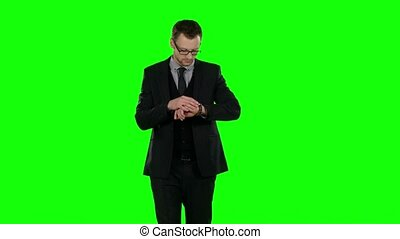 Businessman during phone call. Green screen.