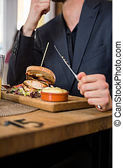 Businessman Eating Food In Restaurant
