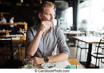 Businessman enjoying coffee