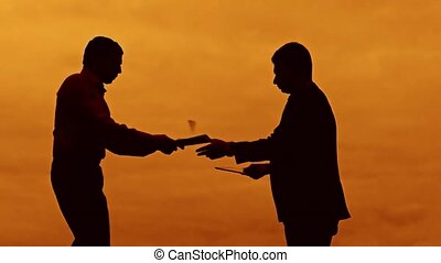 businessman evil boss discussion sunset silhouette sunlight...