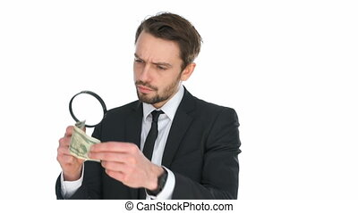 Businessman examining a banknote - Businessman examining a...