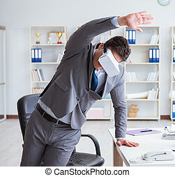 Businessman exercising in office wearing VR glasses
