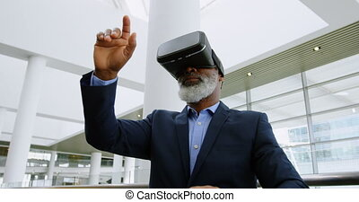Businessman experiencing VR headset in the office 4k - Low...