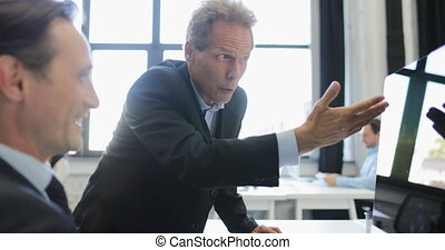 Businessman Explain Idea To Coworker Pointing On Computer Monitor In Modern Office, Successful Business People Team Working