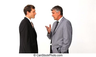 Businessman explaining something to his employee against a ...