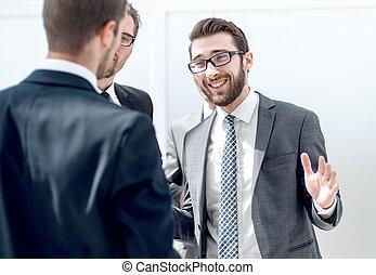 businessman explaining to colleagues his ideas