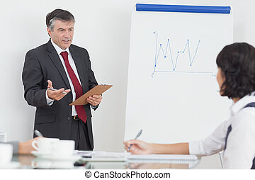 Businessman explaining to his colleague