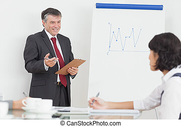 Businessman explaining to his colleague with big smile