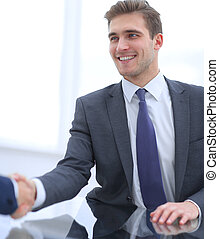 businessman extends his hand to his business partner