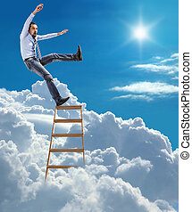 young man in shirt and tie extends slipped and falls from the top of ladder