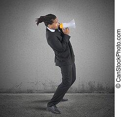 Businessman fearful use the megaphone