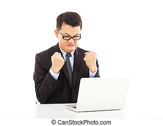 businessman feeling angry and make a fist with laptop