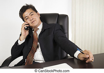 Businessman feeling happy at work