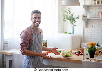 Businessman feeling satisfied after cooking at home