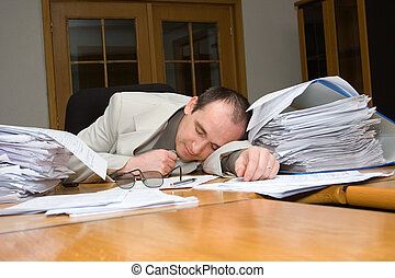 Businessman felt asleep late night in the office